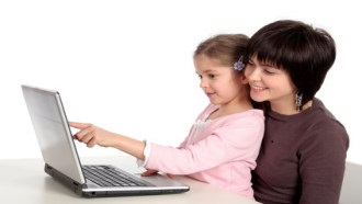 Mother and Daughter sitting at a laptop